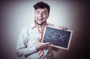 businessman with a blank blackboard write sex